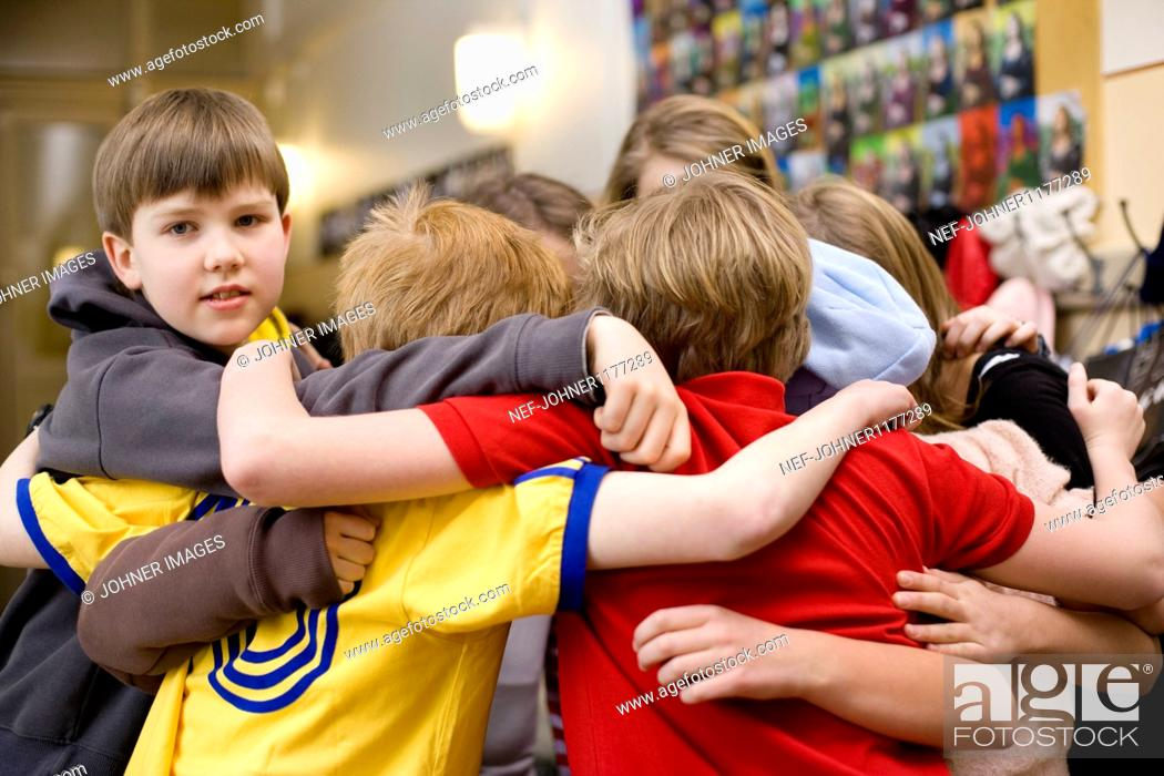 Stock Photo: Children standing in circle and hugging.
