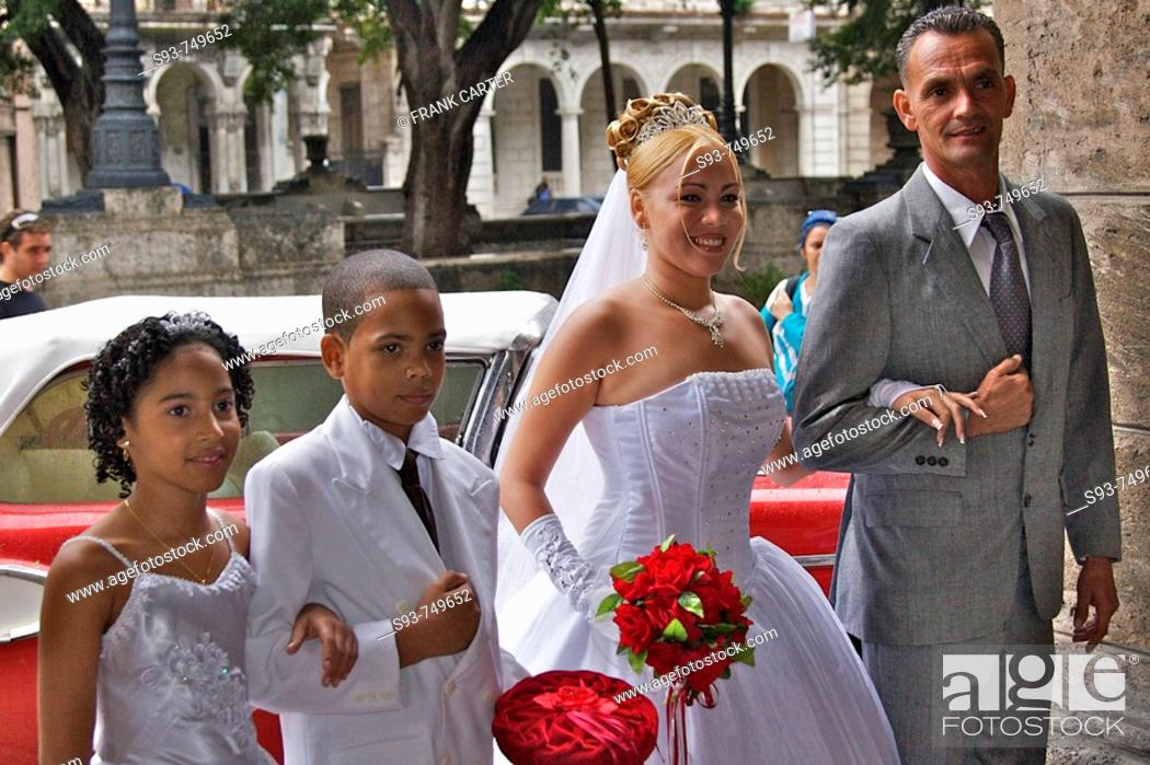Stock Photo: A bride and groom, with attendants just before the wedding ceremony.