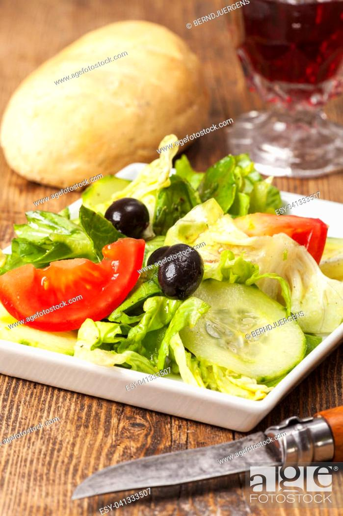 Stock Photo: small salad with black olives.