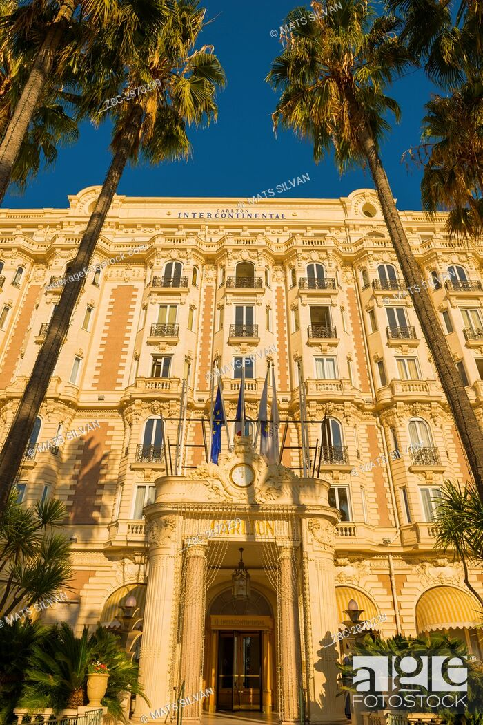 Stock Photo: Hotel Carlton Intercontinental with Palm Trees in Cannes in Provence-Alpes-Côte d'Azur, France.