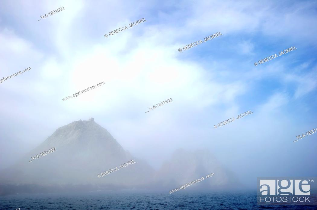 Stock Photo: The Devil's Teeth Farallon Islands rising from a thick marine layer.