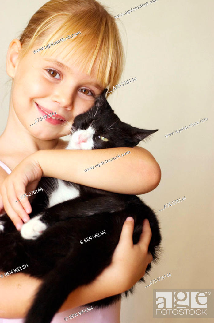 Stock Photo: Girl with cat.