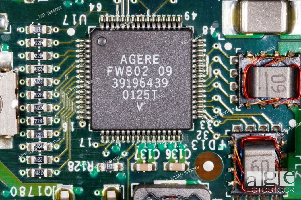 Stock Photo: close up photograph of electronic components on a computer mother board showing surface mount resistors and an integrated circuit.