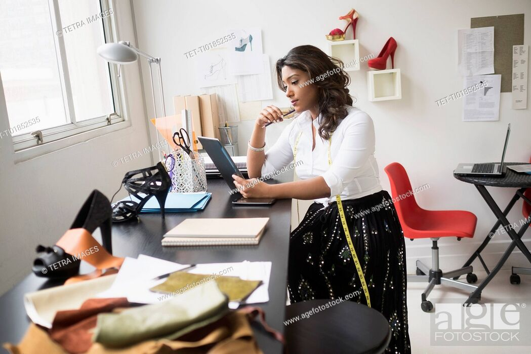 Stock Photo: Young woman working in office.