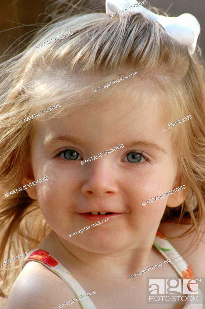 Stock Photo: Close-up of Toddler Girl Smiling.
