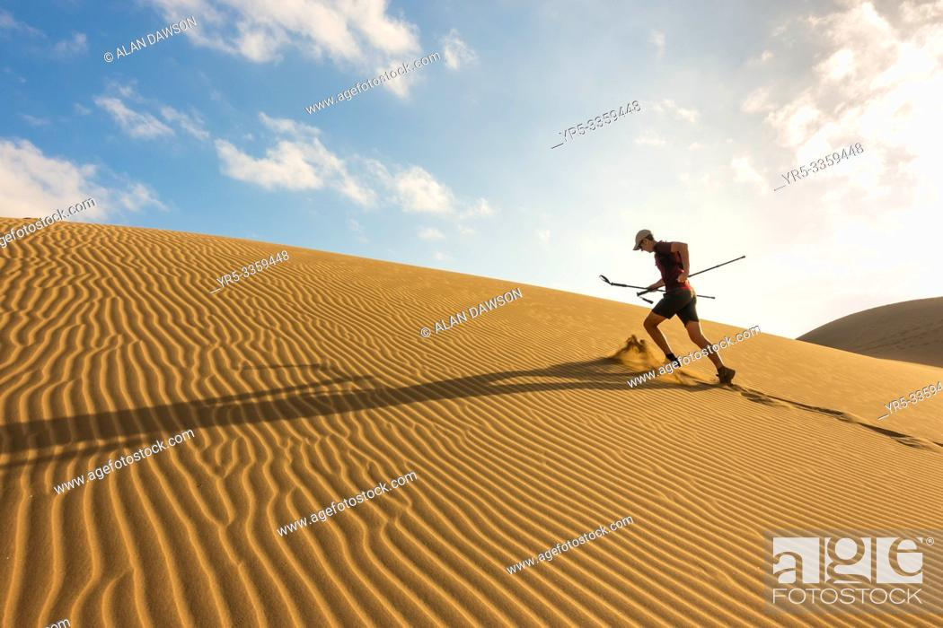 Stock Photo: 62 year old trail runner training on sand dunes at Maspalomas, Gran Canaria, Canary Islands, Spain.
