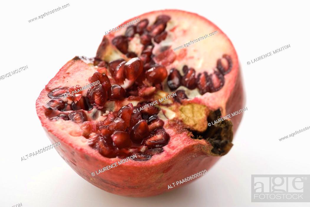 Stock Photo: Fresh cut pomegranate.