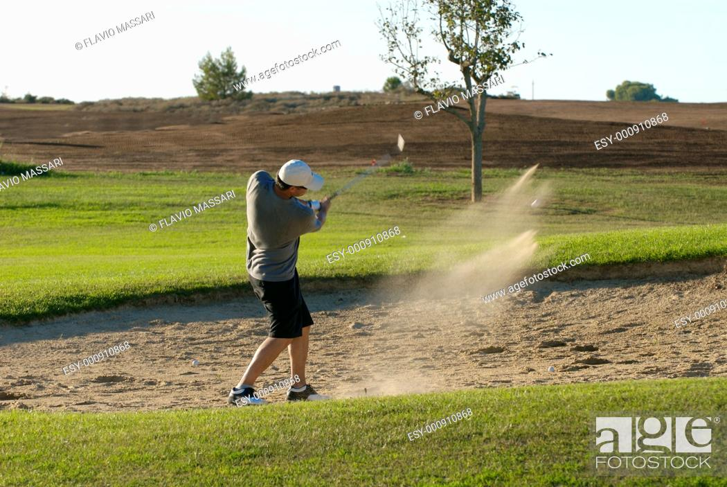 Stock Photo: golf player trying a shot.