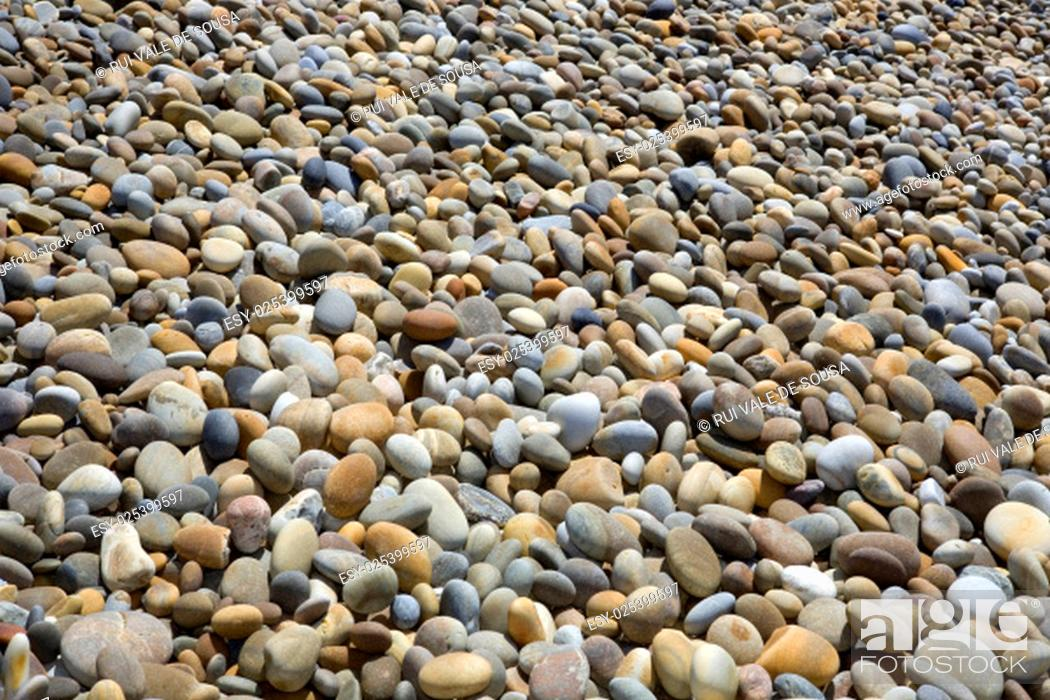 Stock Photo: colorful pebble stone background, at the beach.