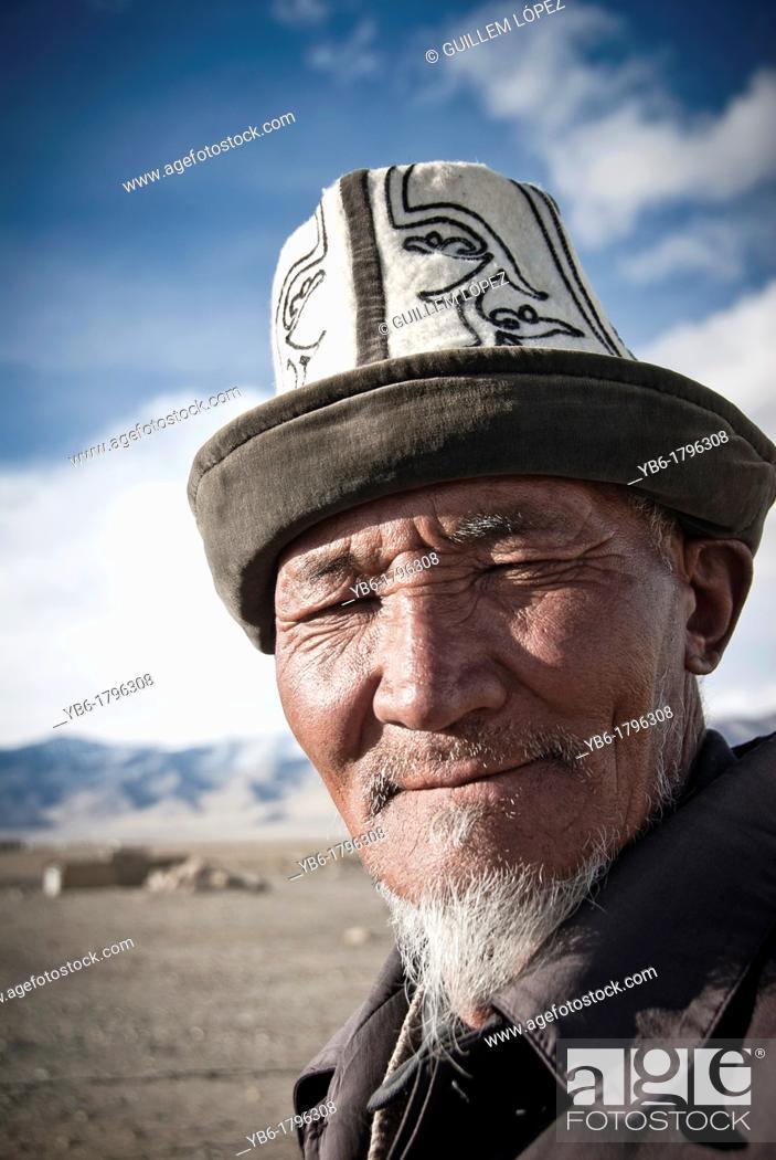 Stock Photo: Portrait of a old Kyrgyz Man with traditional hat Kalpak, Karakul, Tajikistan.