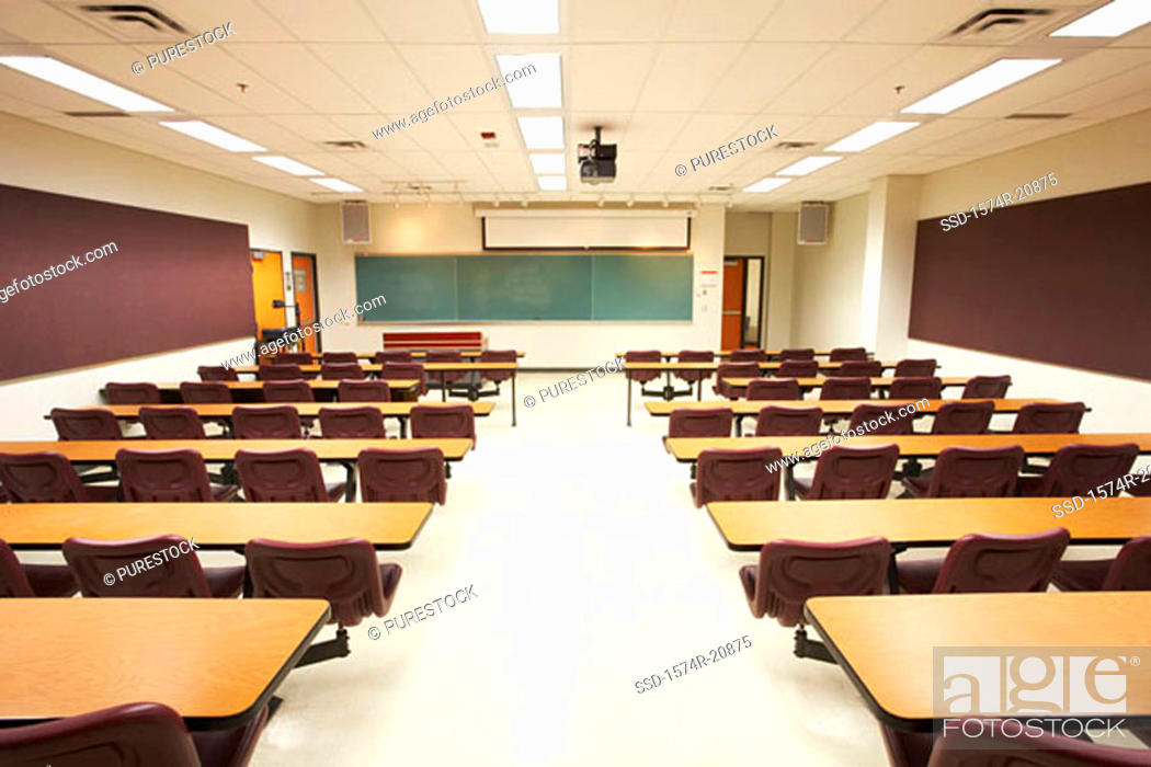Stock Photo: Empty tables and chairs in a lecture hall.