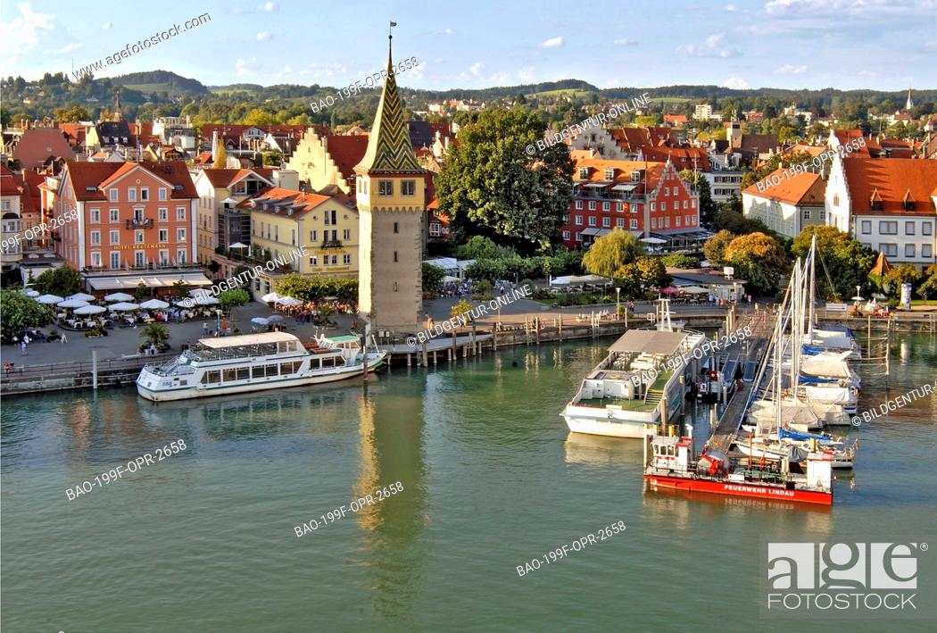 Stock Photo: This stock photo shows the famous historical old town of the Bavarian city of Lindau, in Germany, with the harbour in the foreground.