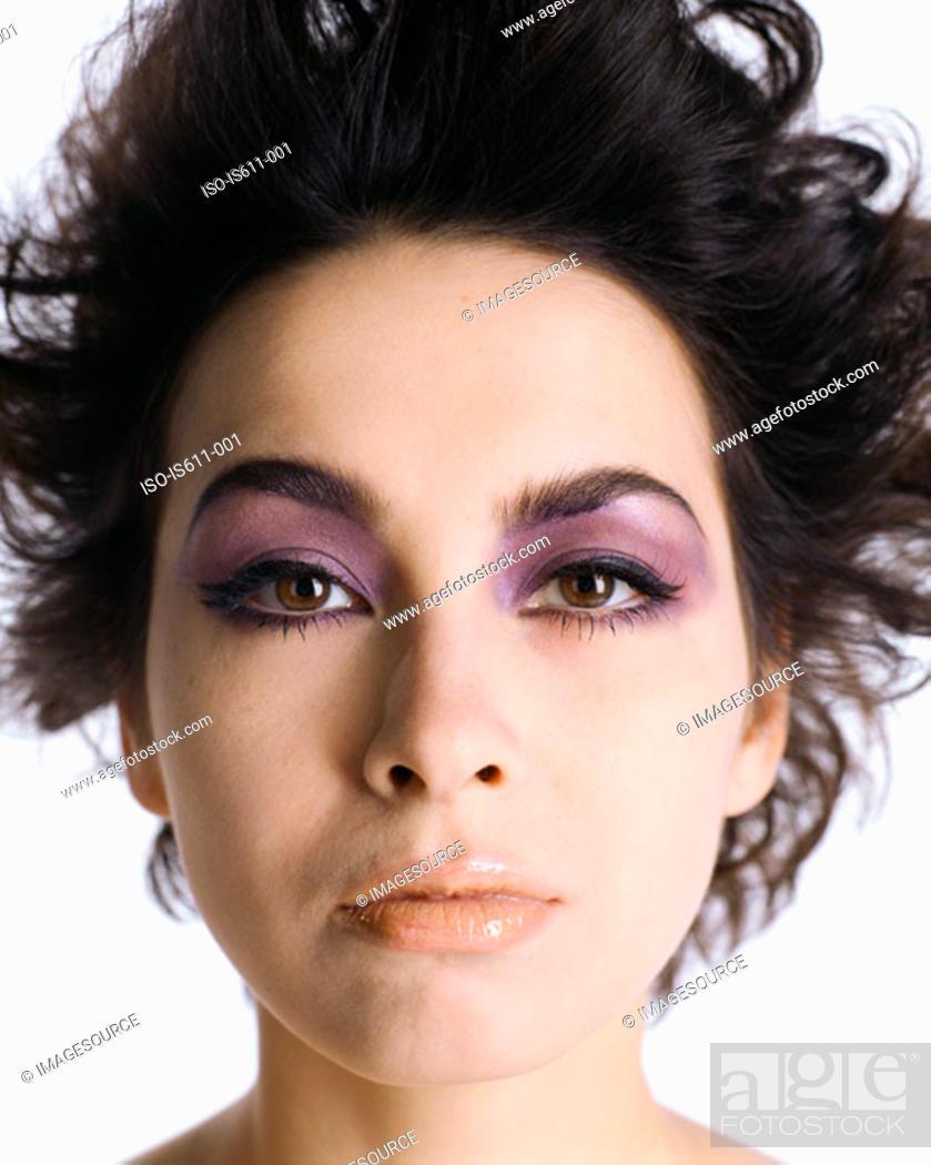 Stock Photo: Headshot of woman wearing dramatic makeup.