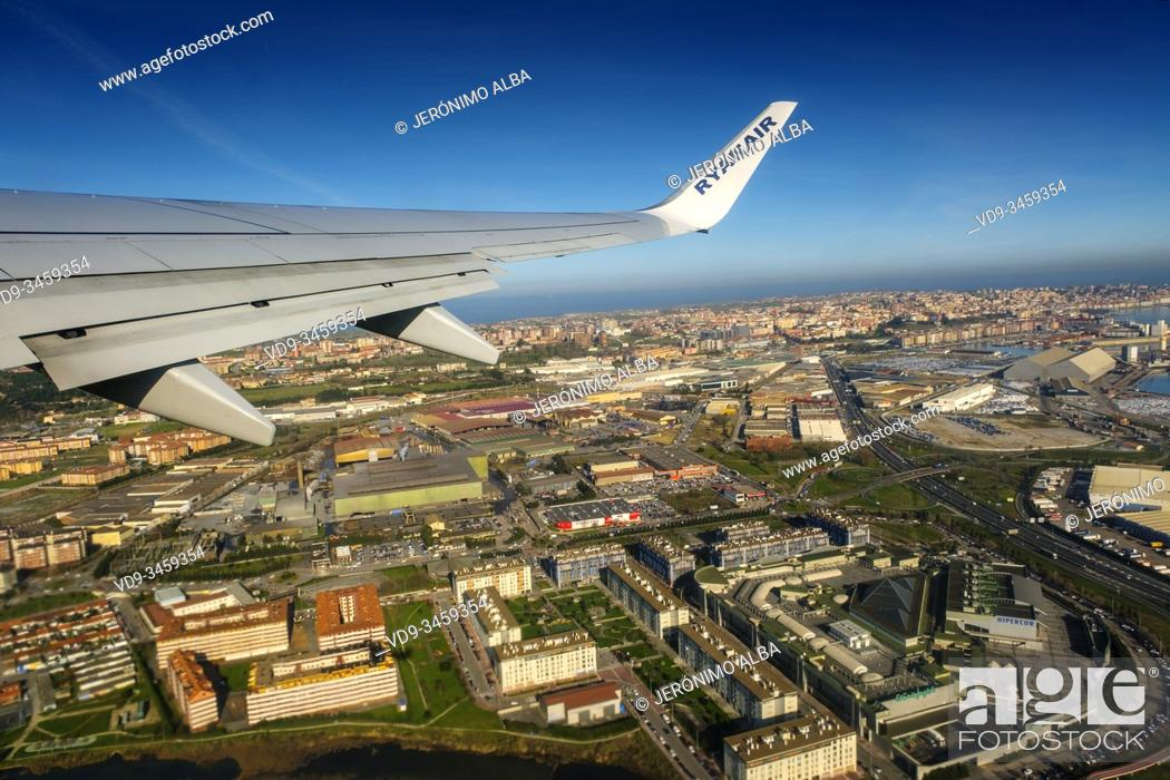 Stock Photo: Plane flying over Santander, Cantabrian Sea. Cantabria, north Spain. Europe.