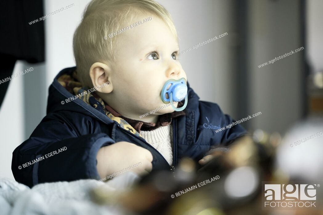 Stock Photo: baby toddler child with pacifier, in Cottbus, Brandenburg, Germany.