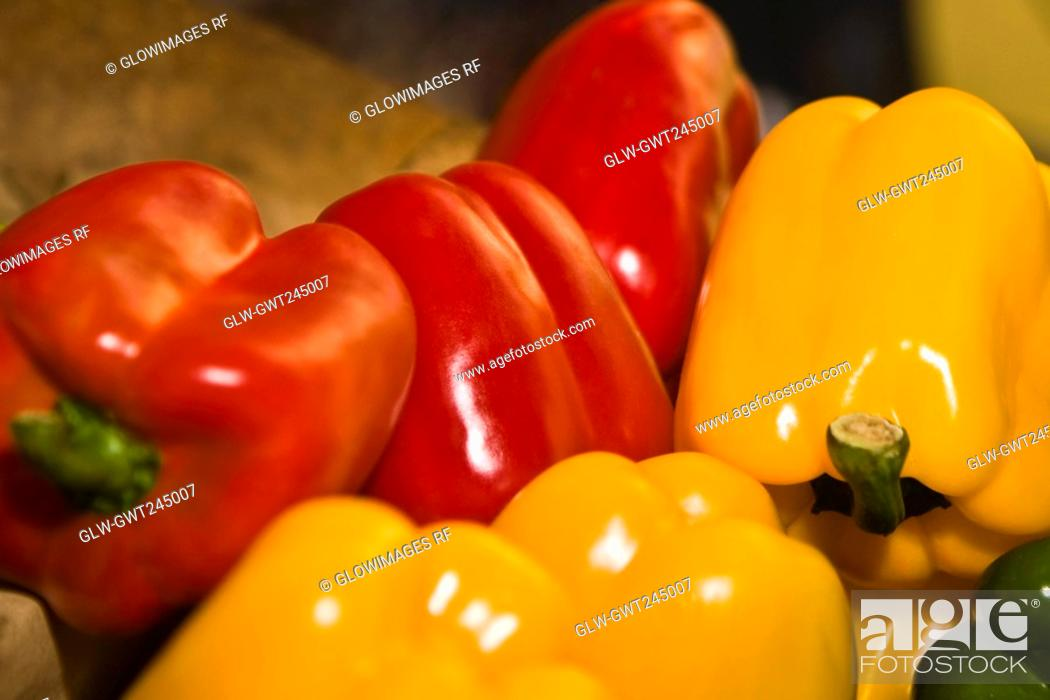 Stock Photo: Close-up of red and yellow bell peppers at a market stall, Zacatecas State, Mexico.