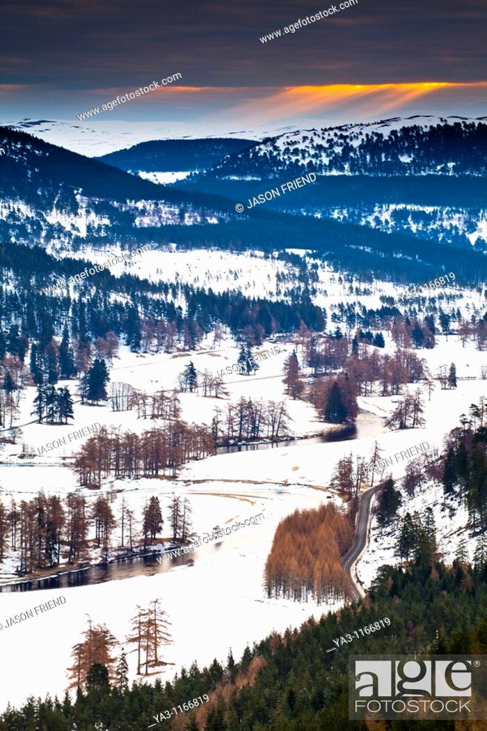 Stock Photo: Scotland, Scottish Highlands, Cairngorms National Park  The River Dee meandering through snow covered fields and mountains near Braemar.