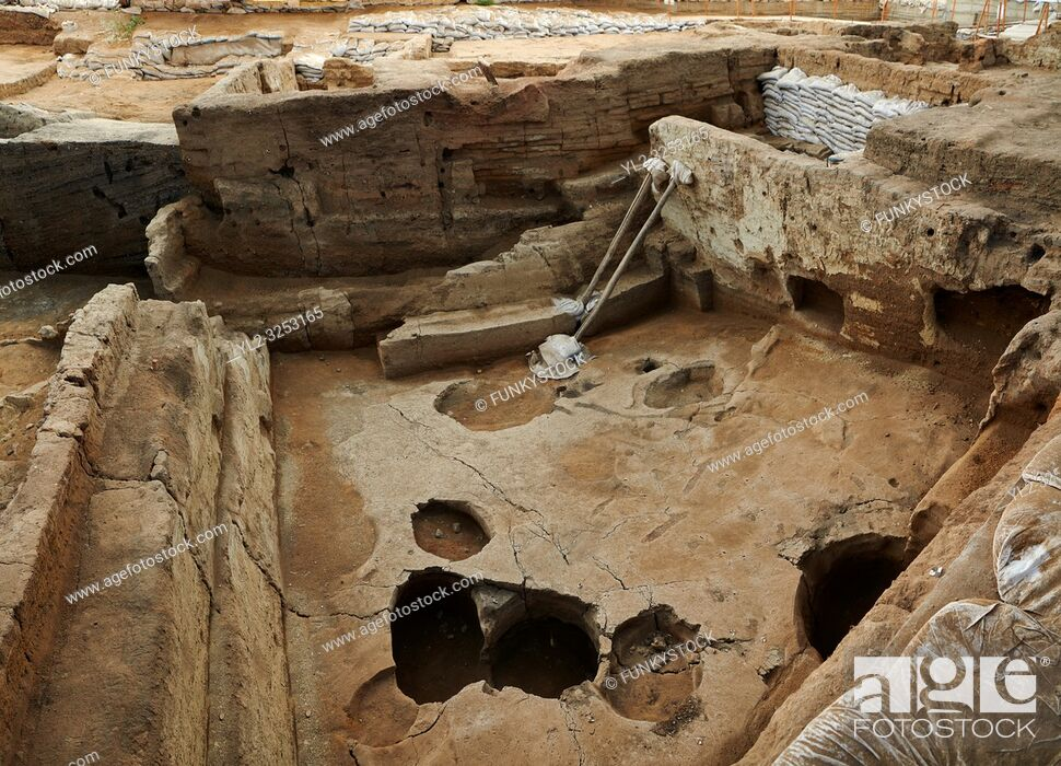 Stock Photo: Building 321. Empty burial pit in the floor of the Neolithic remains of mud brick house. In the top right is a darker area which was the midden or refuse pile.