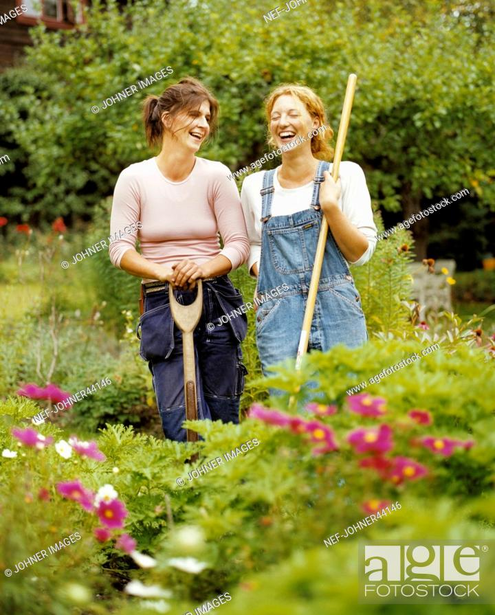 Stock Photo: Women standing in the garden laughing.