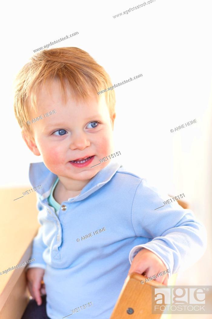 Stock Photo: happy boy looking sideways.