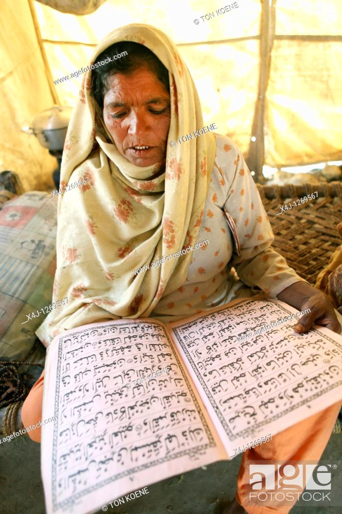 Stock Photo: pakistani learning the koran.