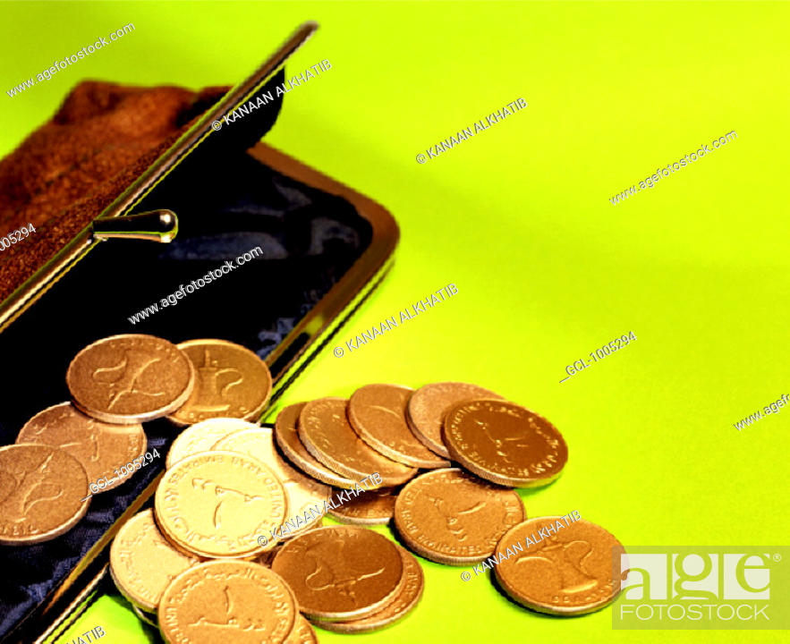 Stock Photo: Purse with coins falling out.