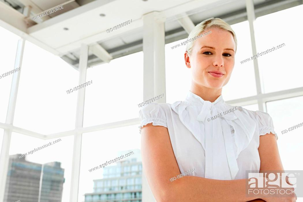 Stock Photo: Businesswoman wearing white blouse, portrait.