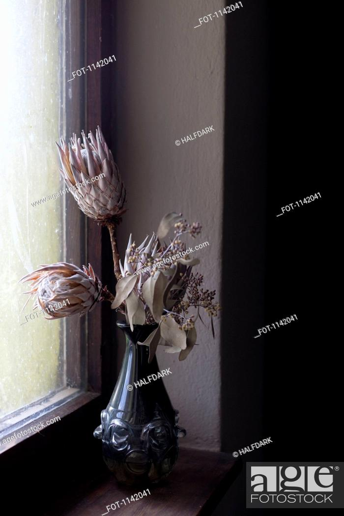 Stock Photo: Dried flowers in a vase.