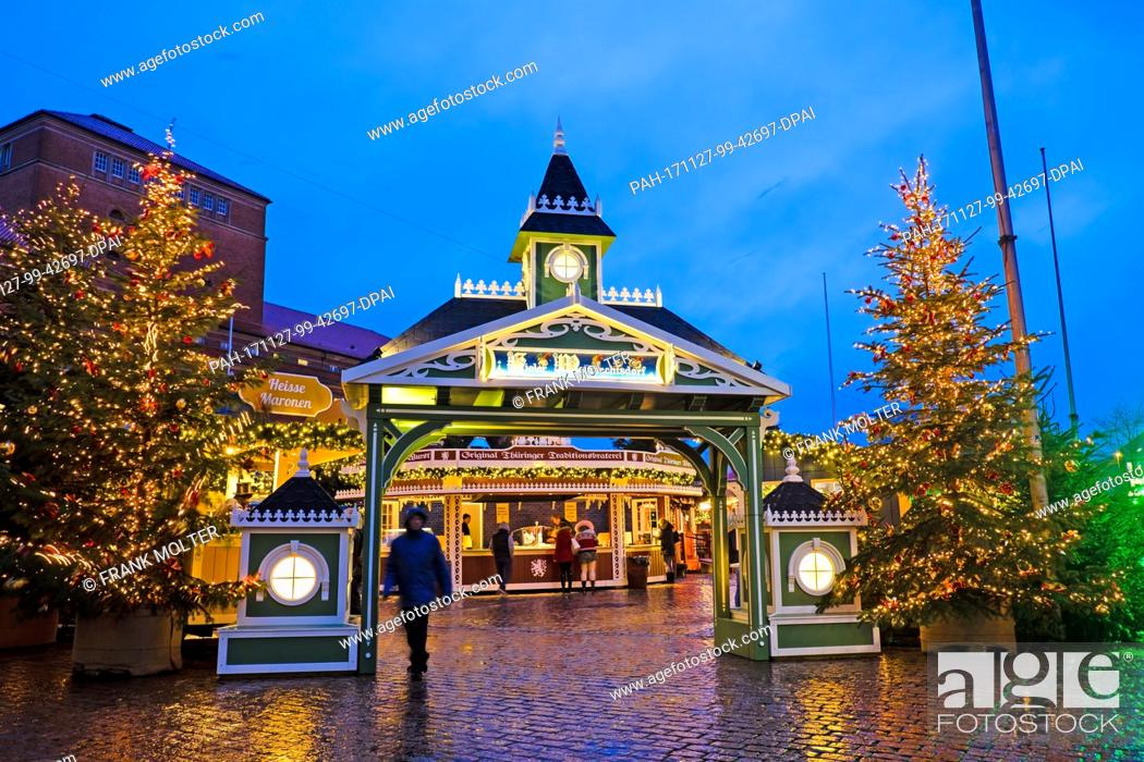 Stock Photo: The entrance of the Kiel Christmas market glows in a festive setting in Kiel, Germany, 27 November 2017. The market has been open since 5pm and will close on 23.