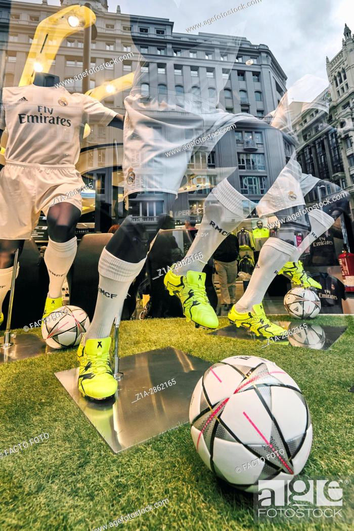 003fa5b9c Stock Photo - Mannequins and reflections at Real Madrid Official Store  window shop at Gran Via street. Madrid. Spain.