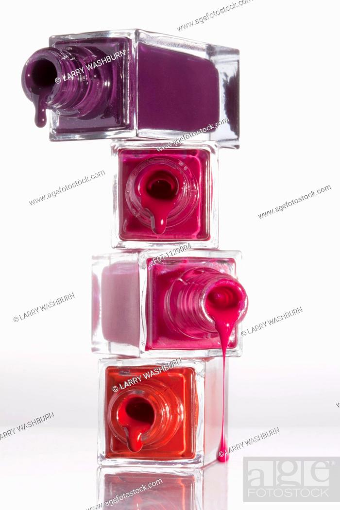 Stock Photo: Nail polish dripping from a stack of bottles.