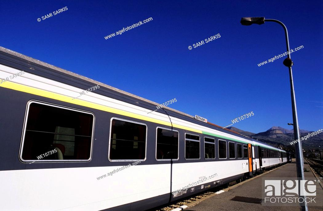 Stock Photo: Train stopped at a railway station, Provence, France.