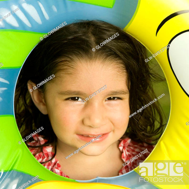 Stock Photo: Portrait of a girl looking through an inflatable ring.