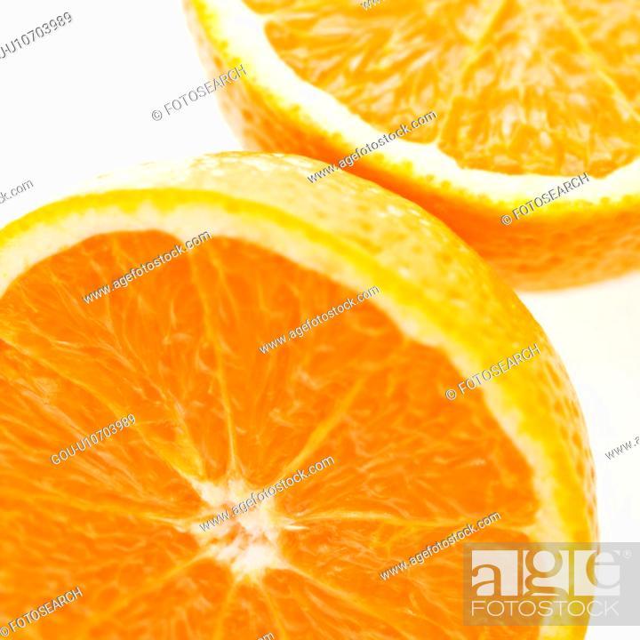 Stock Photo: Close up of halved orange against white background.