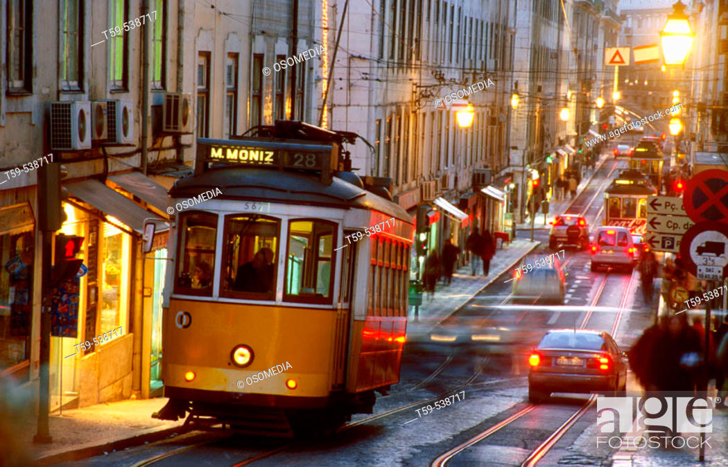 Stock Photo: Electrico in the streets of Baixa in Lisbon at twilight, Portugal.