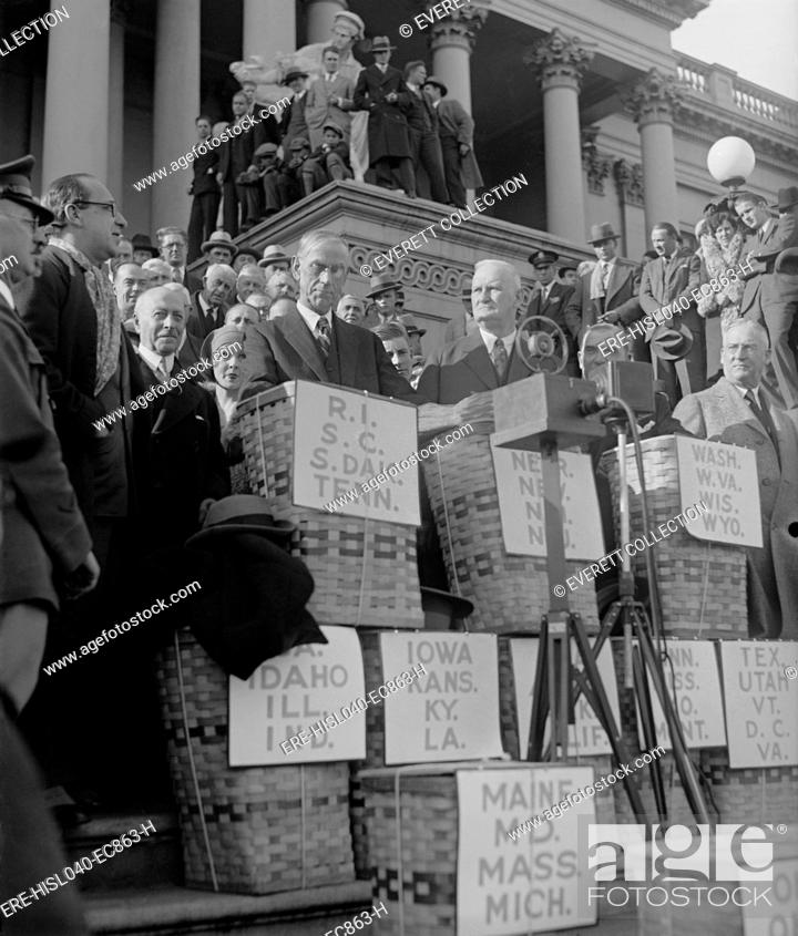Stock Photo: Basket containing huge petitions for reduction of Federal Income Tax in Dec. 1929. The petitions was received by Chairmen of the House and Senate Finance.