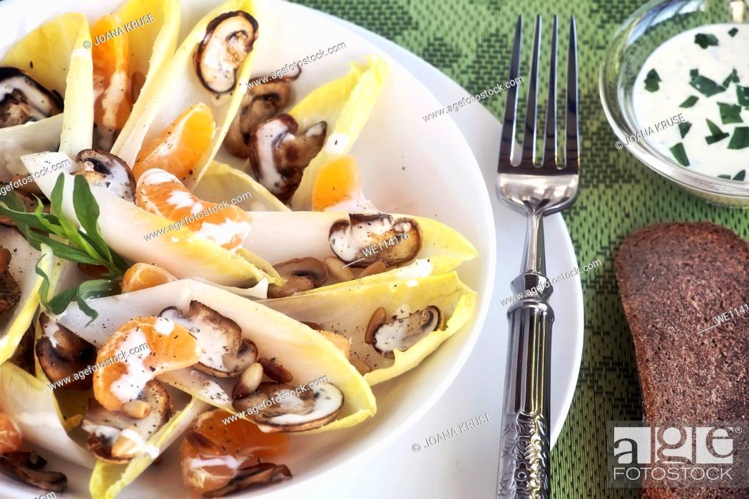 Stock Photo: Chicory salad with mandarin oranges, mushrooms and pine nuts.