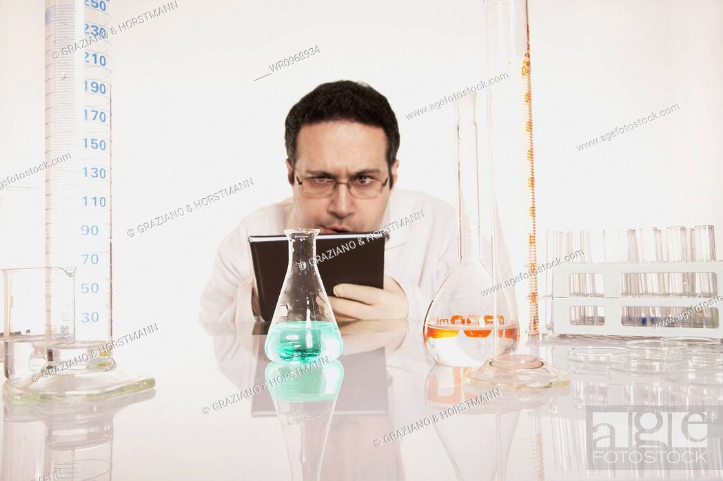 Stock Photo: Working, Concept, Liquid, White, Green, Looking, Laboratory, Document, Assistant, Jacket, Experiment, Coat, Chemist, Fluid, Sceptical