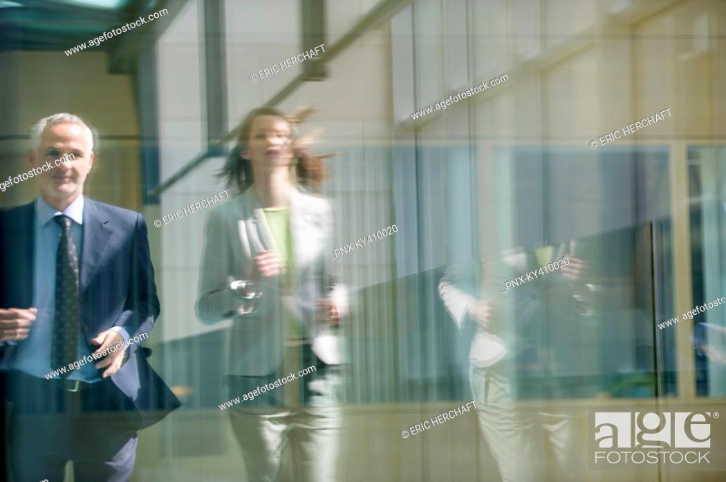 Stock Photo: Two business executives running in the corridor.