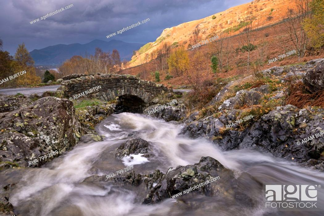 Stock Photo: Rocky stream tumbling under Ashness Bridge in autumn, Lake District National Park, Cumbria, England, United Kingdom, Europe.