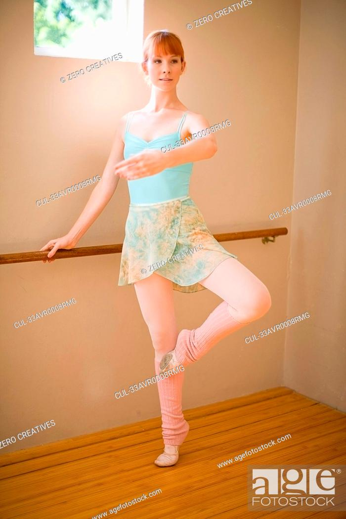Stock Photo: Ballet dancer standing at barre.
