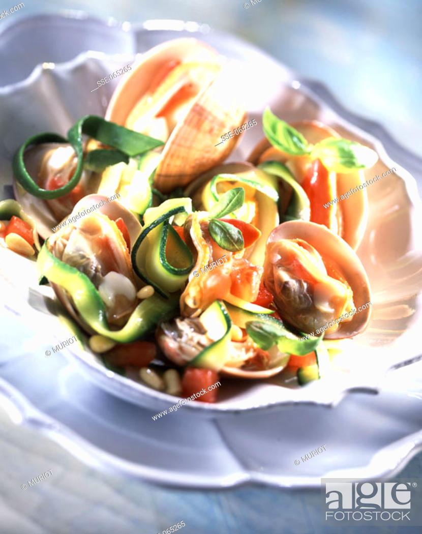Stock Photo: Clam, tagliatelli and courgette salad.