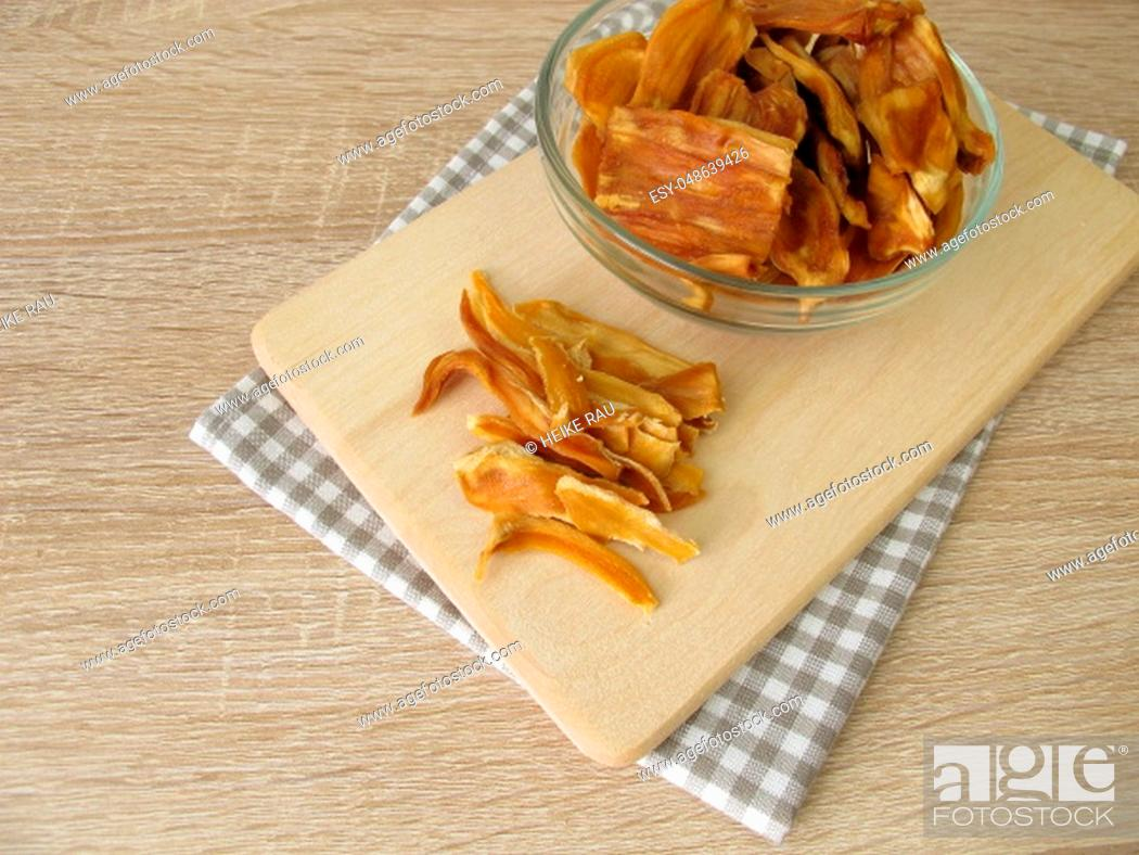 Stock Photo: Dried jackfruit on cutting board.