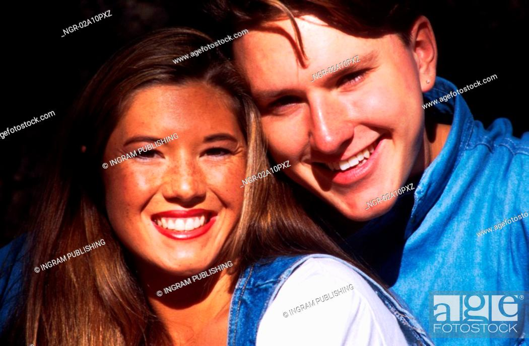 Stock Photo: young couple smiling at camera.