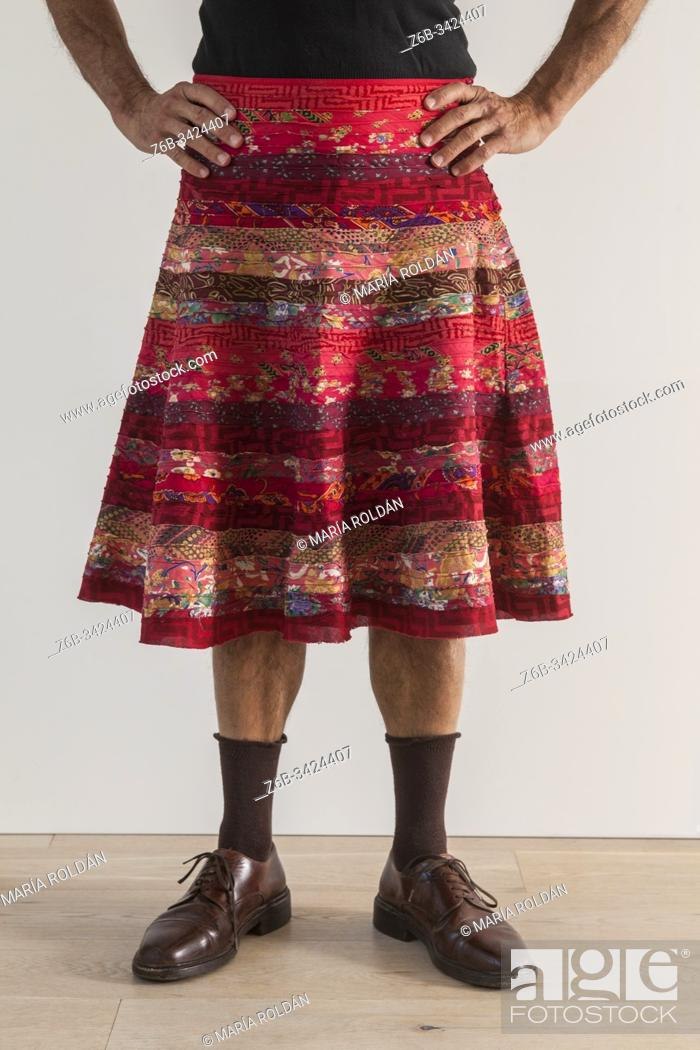 Stock Photo: man wearing a womans skirt.