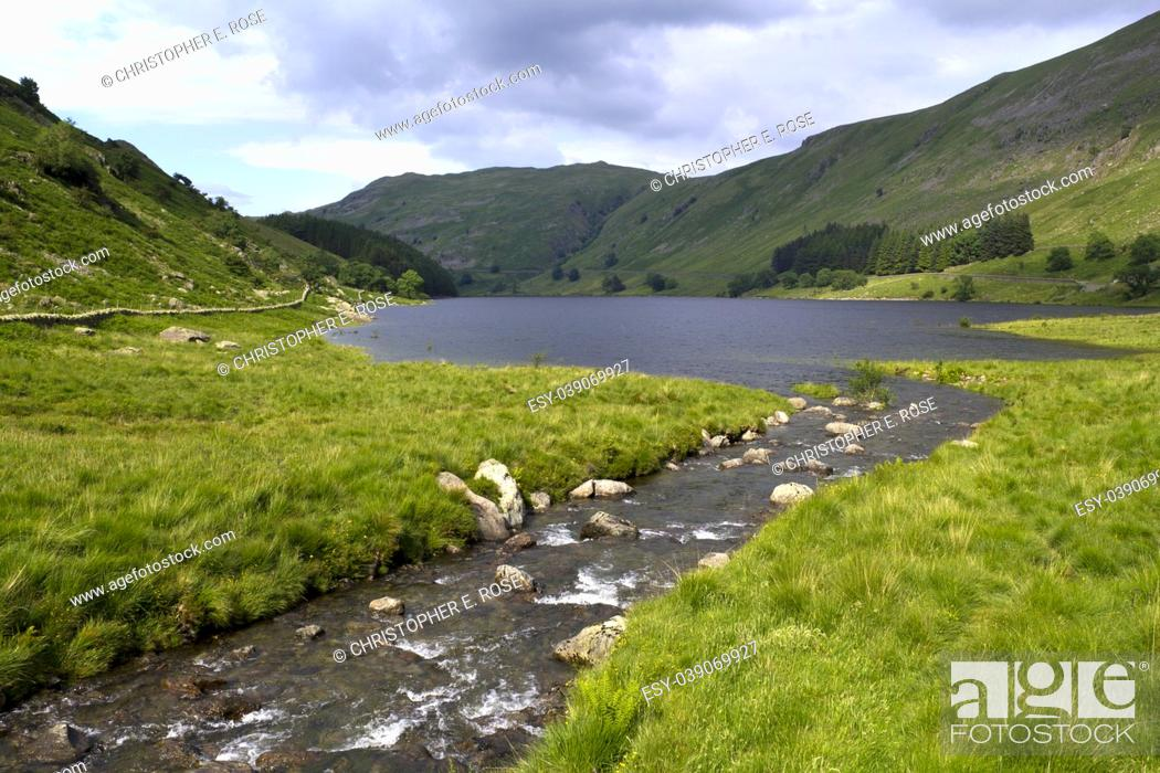 Stock Photo: A picturesque mountain stream feeding into the head of Haweswater reservoir in Mardale valley, Cumbria, UK.