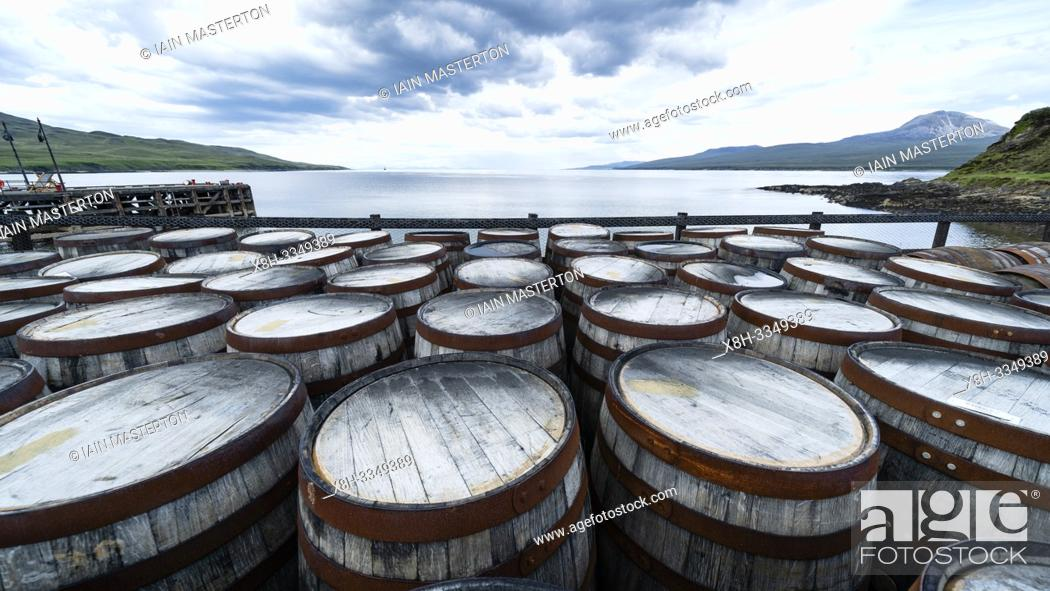 Stock Photo: View of whisky barrels at Bunnahabhain Distillery on island of Islay in Inner Hebrides of Scotland, UK.