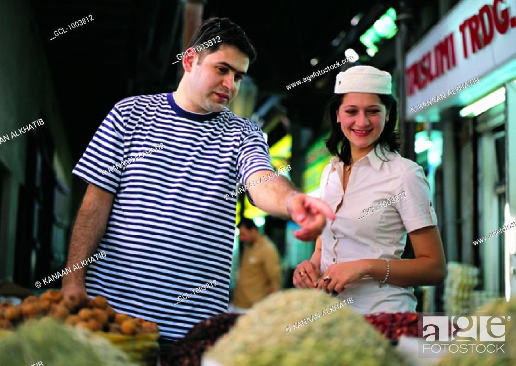 Stock Photo: Western couple on the spice souq in Dubai, United Arab Emirates.