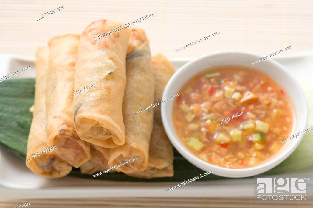 Stock Photo: Spring rolls with dip Asia.