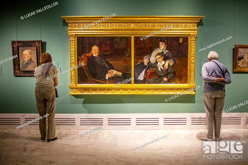 Stock Photo: visitors watching a painting.The Collection Joaquin Sorolla.Museum of Fine Arts.Valencia, Spain.